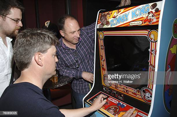 Steve Wiebe plays Donkey Kong as Picturehouse president Bob Berney looks on after the screening of Picturehouse's 'The King of Kong A Fistful of...