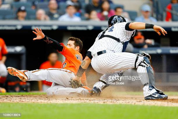 Steve Wilkerson of the Baltimore Orioles is tagged out by Gary Sanchez of the New York Yankees trying to score in the fifth inning at Yankee Stadium...