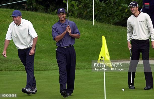 Steve Williams caddie to American golfer Tiger Woods and Australian golfer Adam Scott share a joke during their practice round at Mount Juliet Golf...