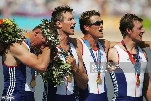 Steve Williams James Cracknell Ed Coode and a tearful Matthew Pinsent of Great Britain receive their medals for the men's four rowing event on August...