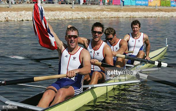 Steve Williams James Cracknell Ed Coode and Matthew Pinsent celebrate their win in the men's four rowing final on August 21 2004 during the Athens...