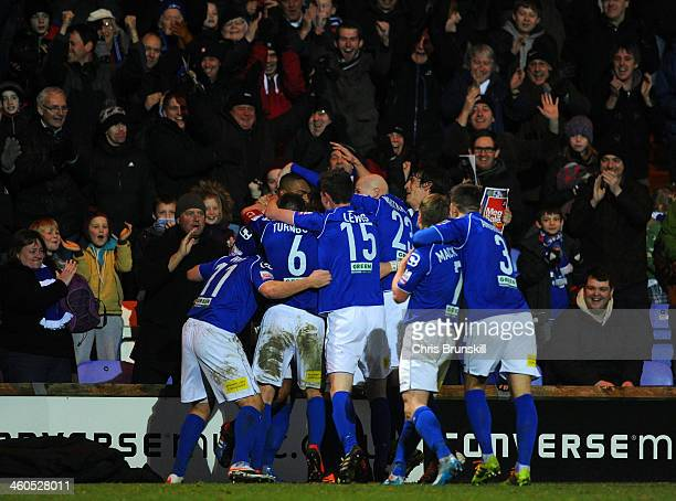 Steve Williams of Macclesfield Town celebrates scoring their first goal with his team mates during the Budweiser FA Cup Third Round match between...