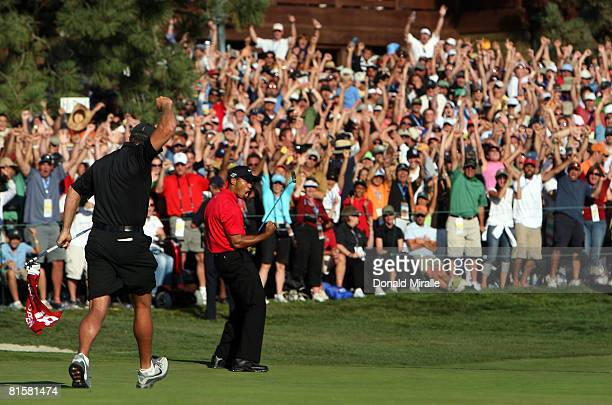 Steve Williams runs towards Tiger Woods as he celebrates his birdie putt on the 18th green to force a playoff with Rocco Mediate during the final...