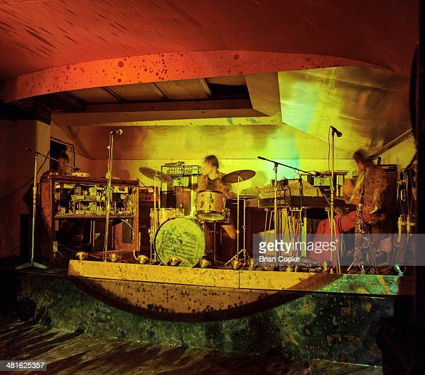 Steve Winwood, Jim Capaldi and Chris Wood of Traffic perform with their psychedelic lightshow at the Kirklevington Country Club near Middlesbrough...