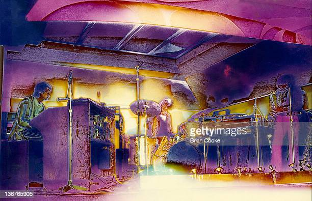 Steve Winwood, Jim Capoldi, Chris Wood of Traffic perform with their psychedelic lightshow at The Kirklevington Country Club near Middlesbrough...