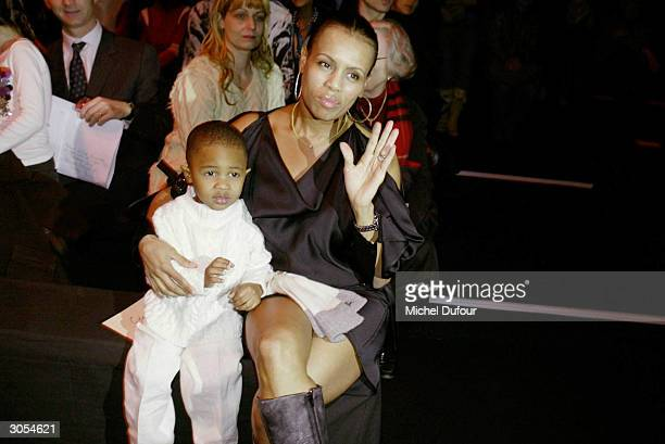 Steve Wonder's wife KarenMillard Morris with son attends John Galliano's readytowear FallWinter collection 20042005 fashion show on March 6 2004 in...