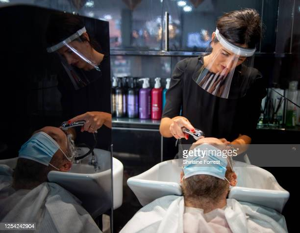 Steve Yates enjoys a long awaited haircut by Amy Davies at Toni Guy in Stockton Heath on July 04 2020 in Warrington England Hairdressing Salons...
