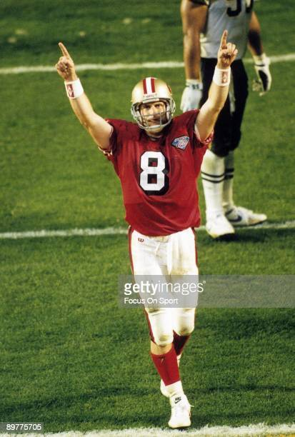 Steve Young of the San Francisco 49ers celebrate after the 49ers scored against the San Diego Chargers during Super Bowl XXIX on January 29 1995 at...
