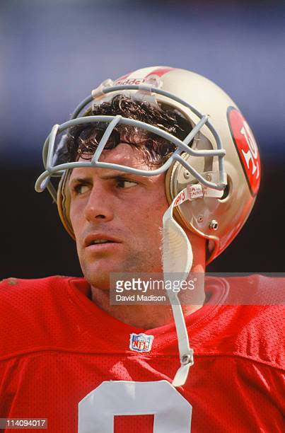 Steve Young of the San Francisco 49ers waits on the sidelines during a National Football League game against the Buffalo Bills played on September 13...