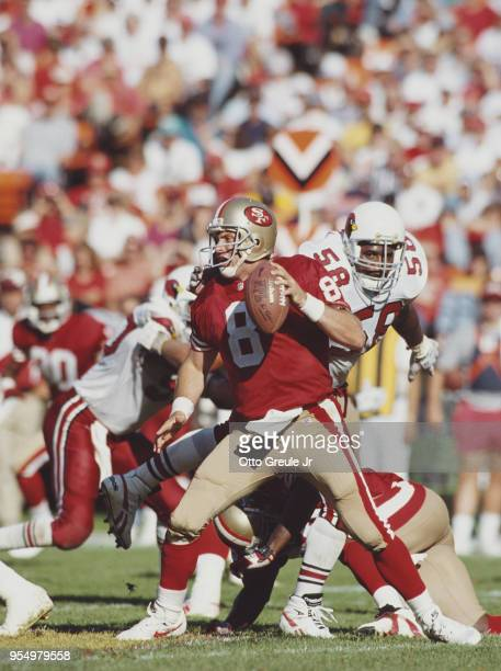 Steve Young Quarterback for the San Francisco 49ers abot to be sacked by Eric Hill during the National Football Conference West Divisional game...