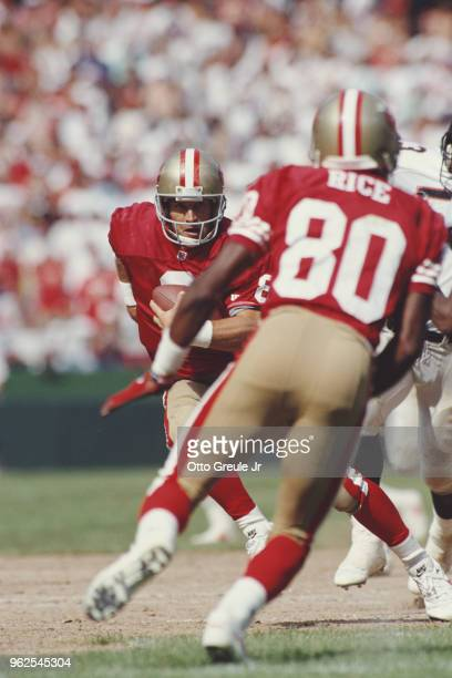 Steve Young Quarterback for the San Francisco 49ers keeps his eye on his wide receiver Jerry Rice during the National Football Conference West...