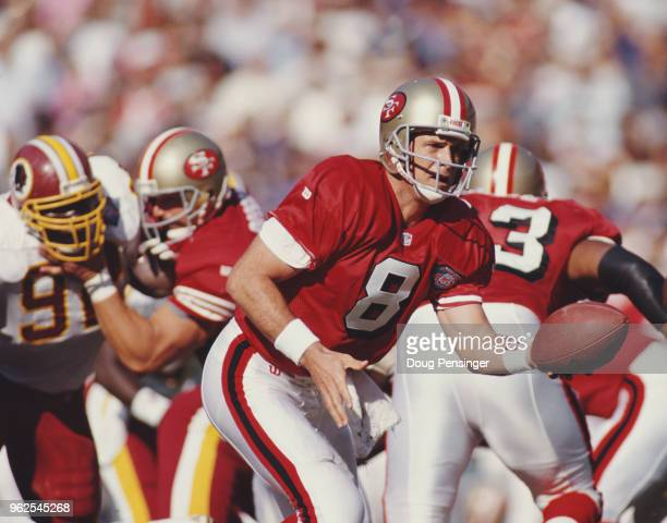 Steve Young Quarterback for the San Francisco 49ers prepares to hand off the ball during the National Football Conference East game against the...