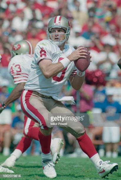 Steve Young Quarterback for the San Francisco 49ers throws the ball downfield during the American Football Conference West game against the Kansas...