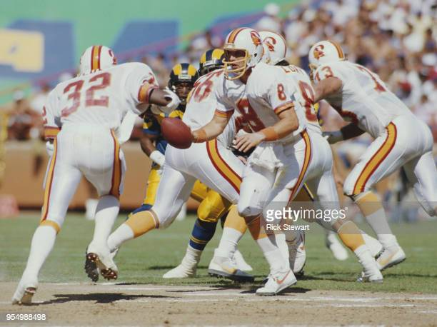 Steve Young Quarterback for the Tampa Bay Buccaneers feeds the ball to Running Back James Wilder during the American Football Conference West game...