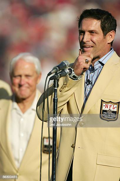 Steve Young talks to the crowd as the 49ers celebrate his induction into the Hall of Fame at halftime during the NFL game between the San Francisco...