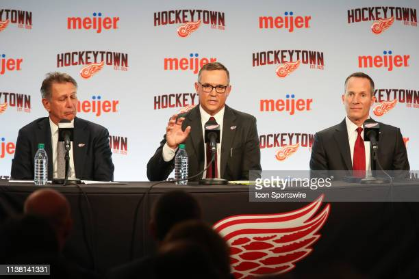 Steve Yzerman addresses members of the media while Ken Holland and Detroit Red Wings Governor President and CEO Christopher Illitch look on during a...