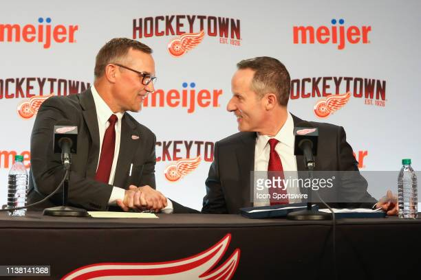 Steve Yzerman and Detroit Red Wings Governor President and CEO Christopher Illitch shake hands during a press conference to introduce Steve Yzerman...