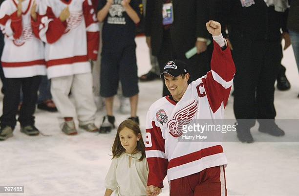 Steve Yzerman and his daughter Isabella go to center ice to have the Stanley Cup presented to him and the Detroit Red Wings after they defeated the...