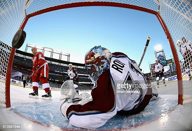 Steve Yzerman of the Detroit Red Wings Alumni scores against goaltender Patrick Roy of the Colorado Avalanche Alumni during the 2016 Coors Light...