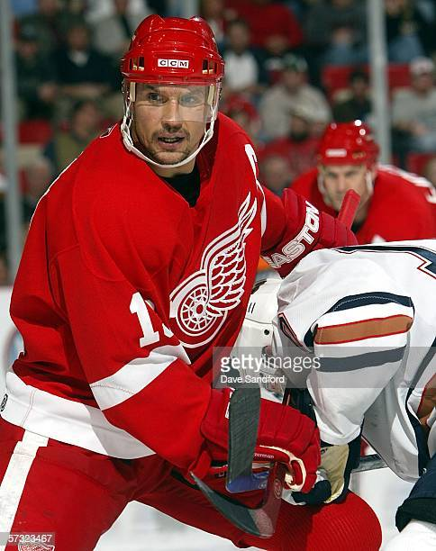 Steve Yzerman of the Detroit Red Wings and Shawn Horcoff of the Edmonton Oilers battle in a face-off during their NHL game at the Joe Louis Arena...