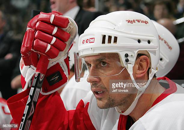 Steve Yzerman of the Detroit Red Wings looks on from the bench during the NHL game against the Vancouver Canucks at General Motors Place on November...