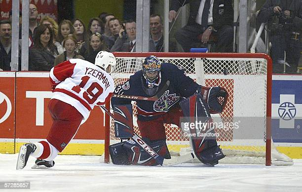 Steve Yzerman of the Detroit Red Wings rings a shot off the crossbar against Marc Denis of the Columbus Blue Jackets during their shootout at Joe...