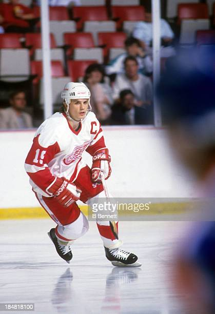 Steve Yzerman of the Detroit Red Wings skates on the ice during an NHL game in December 1988 at the Joe Louis Arena in Detroit Michigan