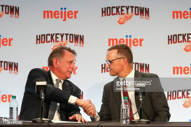 Steve Yzerman shakes hands with Ken Holland during a press conference to introduce Steve Yzerman as the new Executive Vice President and General...