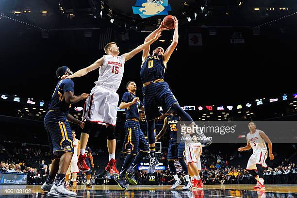 Steve Zack of the La Salle Explorers attempts a rebound with Oskar Michelsen of the Davidson Wildcats during a quarterfinal game in the 2015 Men's...