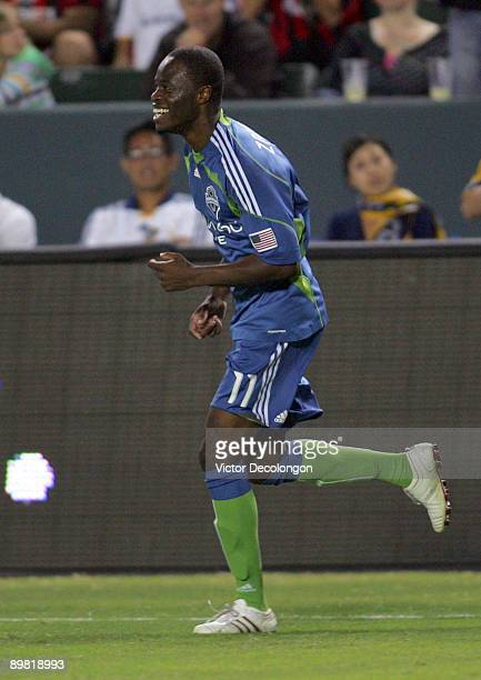 Steve Zakuani of Seattle Sounders FC smiles after scoring a goal in the first half against the Los Angeles Galaxy during the MLS match at The Home...
