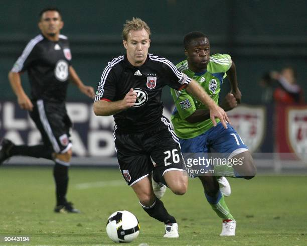 Steve Zakuani of the Seattle Sounders chases after Bryan Namoff of DC United during the final of the US Open Cup won by Seattle 21 at RFK Stadium on...