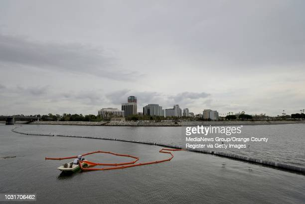 Steve Zieg and Ron Blackledge, of Frey Environmental, ready the trash boom at the mouth of the Los Angeles River in Long Beach on Wednesday. Zieg...