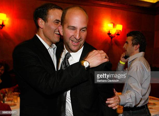 Steve Zimmer gets a hug from his campaign manager,Greg Good, as he arrives to his victory party at Musso and Frank Grill in Hollywood March 03, 09...