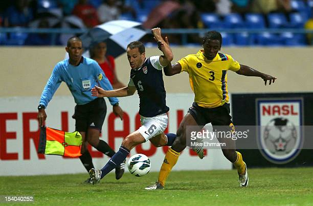 SteveCherundolo of the United States fights for a ball against Zaine FrancisAngol of Antigua and Barbuda during a World Cup Qualifying game at Sir...