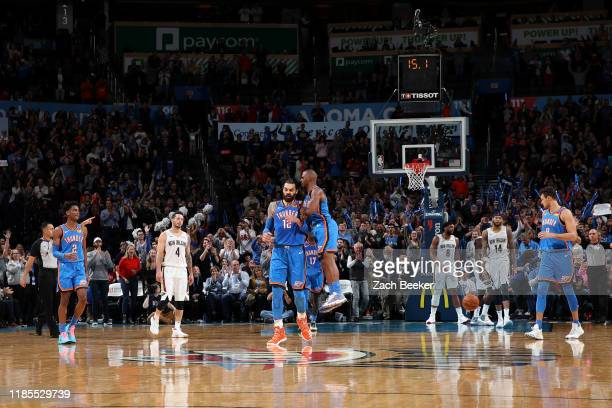 Steven Adams and Chris Paul of the Oklahoma City Thunder react to a play against the New Orleans Pelicans on November 29 2019 at Chesapeake Energy...