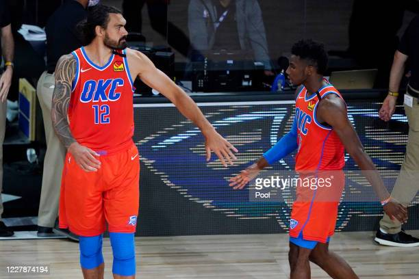 Steven Adams and Hamidou Diallo of the Oklahoma City Thunder celebrate after defeating the Utah Jazz in an NBA basketball game on August 1, 2020 in...