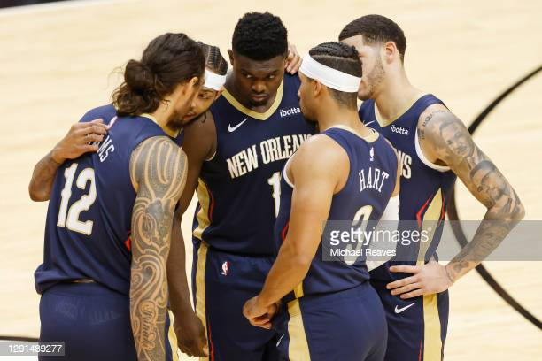 Steven Adams, Brandon Ingram, Zion Williamson, Josh Hart and Lonzo Ball of the New Orleans Pelicans huddle during the first quarter of a preseason...