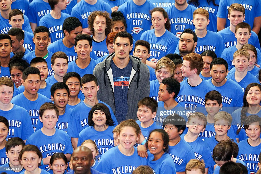 Steven Adams of Oklahoma City Thunder poses with children during the New Zealand Basketball Academy Launch at ASB Sports Centre on August 17, 2014 in Wellington, New Zealand.