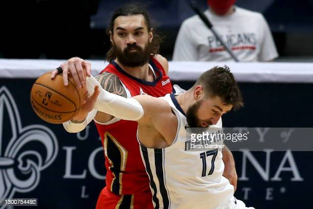 Steven Adams of the New Orleans Pelicans is fouled by Jonas Valanciunas of the Memphis Grizzlies during the second quarter of an NBA game at Smoothie...