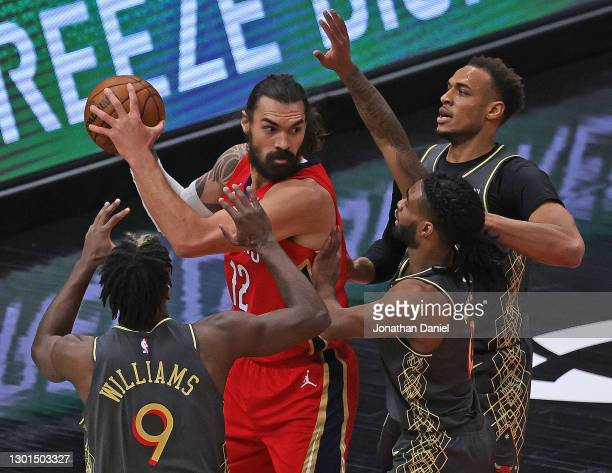 Steven Adams of the New Orleans Pelicans looks to pass under pressure from Patrick Williams, Coby White and Daniel Gafford of the Chicago Bulls at...