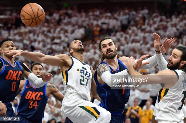 Steven Adams of the Oklahoma City Thunder along with Rudy Gobert and Ricky Rubio of the Utah Jazz look to the loose ball in the second half during...