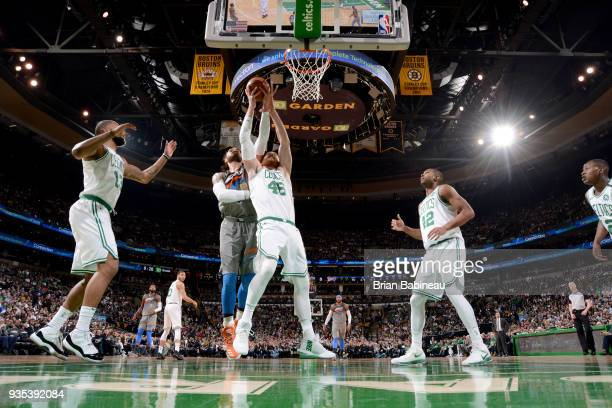 Steven Adams of the Oklahoma City Thunder and Aron Baynes of the Boston Celtics goes up for a rebound on March 20 2018 at the TD Garden in Boston...
