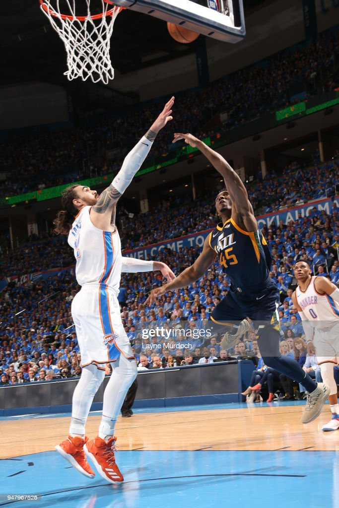 Steven Adams #12 of the Oklahoma City Thunder and Donovan Mitchell #45 of the Utah Jazz wait for the ball during Game One of Round One of the 2018 NBA Playoffs on April 15, 2018 at Chesapeake Energy Arena in Oklahoma City, Oklahoma.