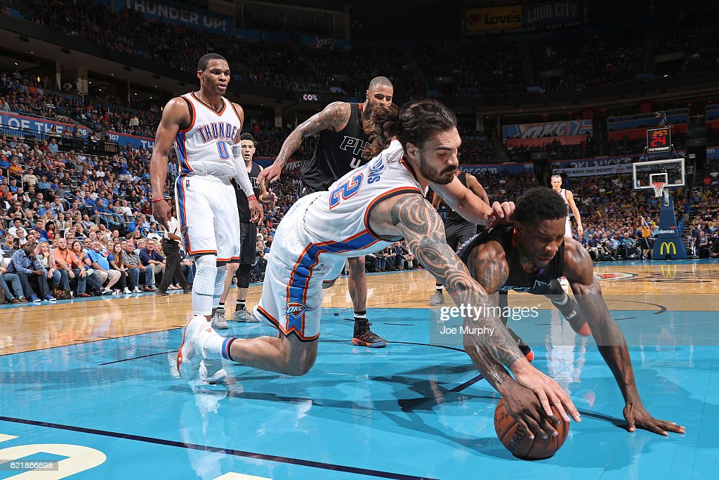 Steven Adams #12 of the Oklahoma City Thunder and Eric Bledsoe #2 of the Phoenix Suns chase after a loose ball on October 28, 2016 at the Chesapeake Energy Arena in Oklahoma City, Oklahoma.