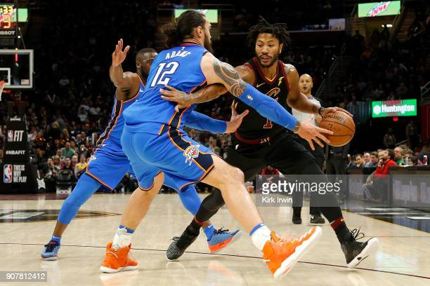 Steven Adams of the Oklahoma City Thunder attempts to knock the ball away from Derrick Rose of the Cleveland Cavaliers during the fourth quarter at...