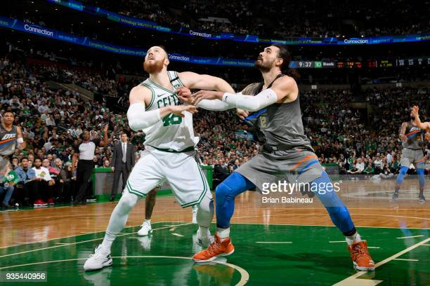 Steven Adams of the Oklahoma City Thunder battles for position against Aron Baynes of the Boston Celtics on March 20 2018 at the TD Garden in Boston...