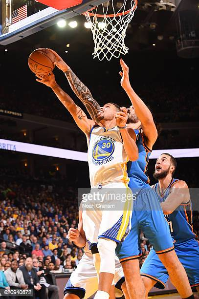 Steven Adams of the Oklahoma City Thunder blocks a shot by Stephen Curry of the Golden State Warriors during a game on November 3 2016 at ORACLE...