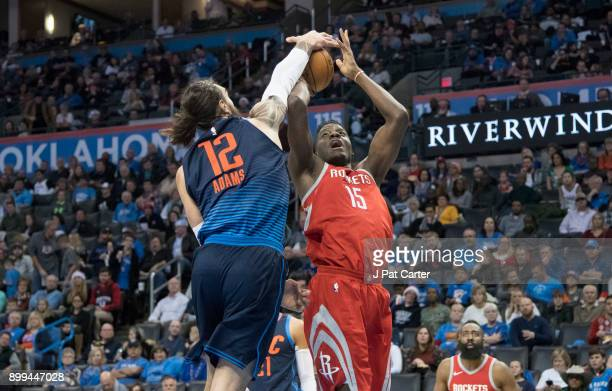 Steven Adams of the Oklahoma City Thunder blocks Clint Capela of the Houston Rockets during the second half of a NBA game at the Chesapeake Energy...