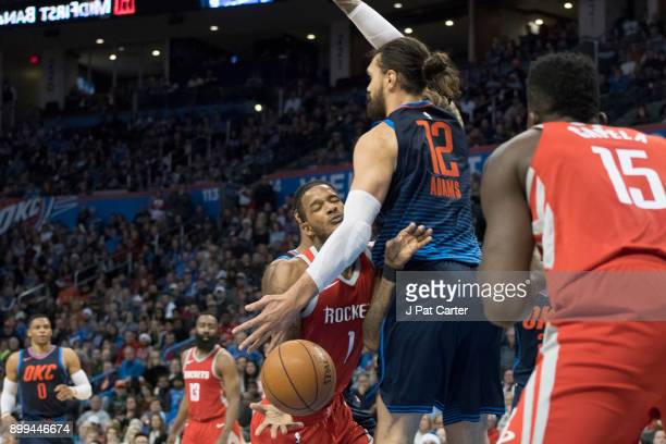 Steven Adams of the Oklahoma City Thunder blocks Trevor Ariza of the Houston Rockets during the second half of a NBA game at the Chesapeake Energy...