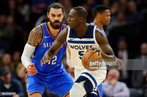Steven Adams of the Oklahoma City Thunder defends against Gorgui Dieng of the Minnesota Timberwolves during the game on January 10 2018 at the Target...